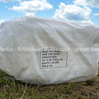 A bale of Chinese made sandbags awaits being filled along the foot of the Nutwood levee.