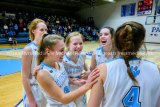 Jersey's Clare Breden being congratulated by teammates after getting 1000th high school career points.