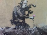 """Camera Man and Flower"" by Banksy. Stencil on concrete. 2010."