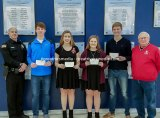 The D.AR.E. scholarship winners from Jersey this year are shown. Shown are D.A.R.E. officer Rich Portwood, Blake Wittman, Caitlin King, Taylor Young, Alec Fry and board member Bob Jones.