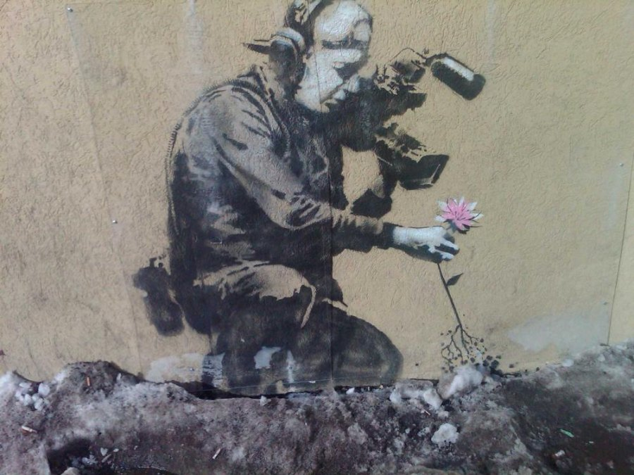 """""""Camera Man and Flower"""" by Banksy. Stencil on concrete. 2010."""