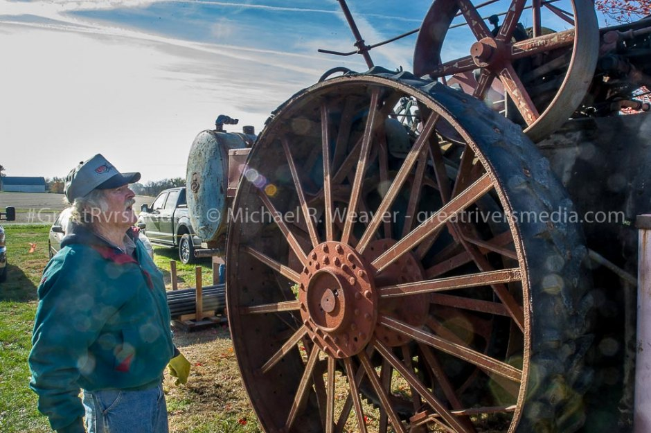 Auction attendee examines Reeves steam Traction engine before auction begins.